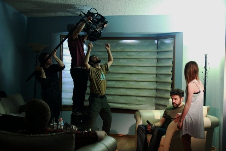 A still from the set of the short film Apparitions. Film crew actively doing a shot.