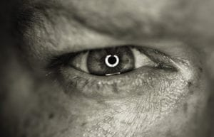 A man with a catchlight in his eye
