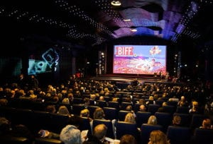 An audience of people at a film festival
