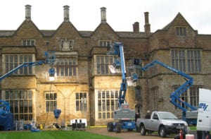 A crew filming at a mansion location