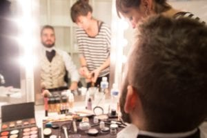 An actor getting their makeup done
